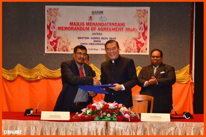 Majlis menandatangani antara Sintok Agro Sdn BHD dan DXN Holdings BHD