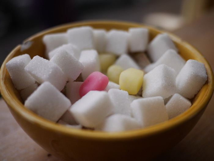 Sugar cubes and candy in a bowl