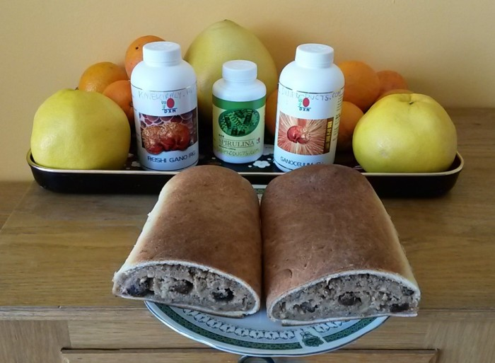 Acidic and alkaline foods DXN products and traditional Hungarian cake: beigli filled with nuts.