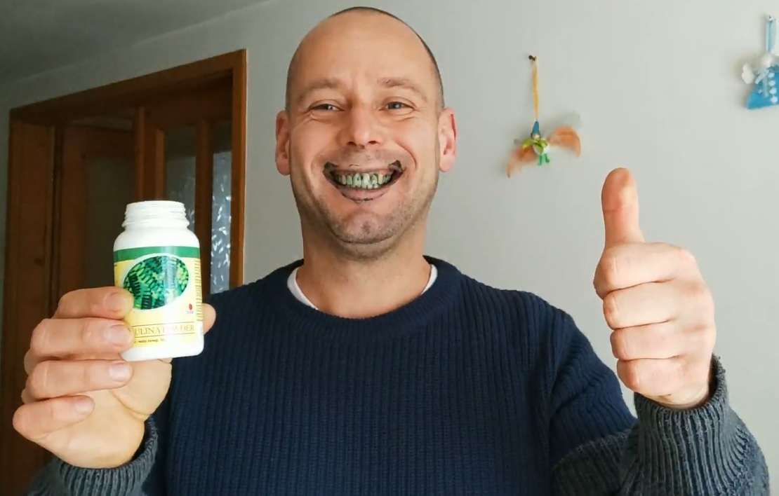 I grin with green teeth from DXN Spirulina